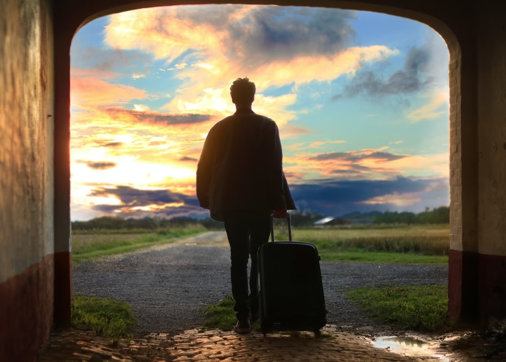Man with suitcase embarking on an adventure